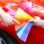 Customer choosing color over red car background